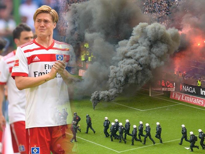 หัวร้อน !! แฟนบอลฮัมบูร์กเดือดทีมตกชั้นปาพลุไฟลงสนาม